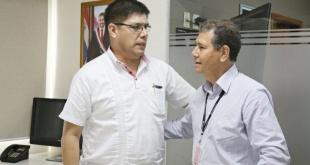 El Dr. Juan Carlos Portillo y el gerente ejecutivo Abg. Pablino Cáceres.