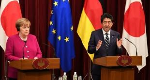 La canciller alemana, Ángela Merkel, y el primer ministro de Japón, Shinzo Abe.