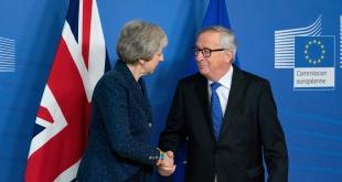 La primera ministra británica, Theresa May, y el titular de la Comisión Europea, Jean-Claude Juncker.